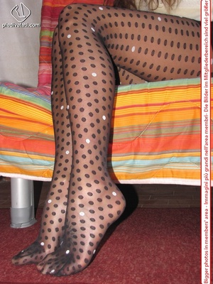 Playful brunette freshie in a white blouse teasing you with her slim legs in polka-dot tights - XXXonXXX - Pic 10
