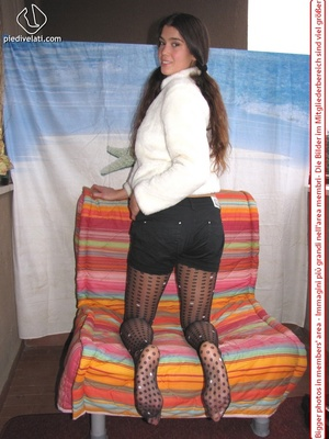 Playful brunette freshie in a white blouse teasing you with her slim legs in polka-dot tights - XXXonXXX - Pic 11
