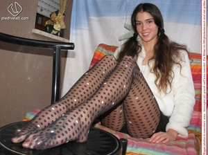 Playful brunette freshie in a white blouse teasing you with her slim legs in polka-dot tights - XXXonXXX - Pic 15