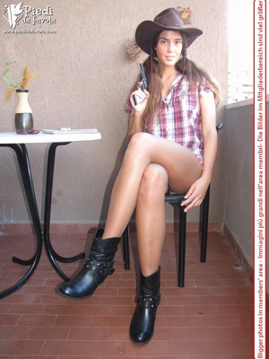 Little brunette pigtailed cowgirl wearing a hat, checked shirt and pantyhose looking dangerous with her gun - XXXonXXX - Pic 2