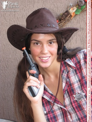 Little brunette pigtailed cowgirl wearing a hat, checked shirt and pantyhose looking dangerous with her gun - XXXonXXX - Pic 3