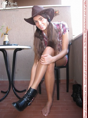 Little brunette pigtailed cowgirl wearing a hat, checked shirt and pantyhose looking dangerous with her gun - XXXonXXX - Pic 6