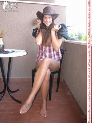 Little brunette pigtailed cowgirl wearing a hat, checked shirt and pantyhose looking dangerous with her gun - XXXonXXX - Pic 7