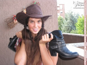 Little brunette pigtailed cowgirl wearing a hat, checked shirt and pantyhose looking dangerous with her gun - XXXonXXX - Pic 8