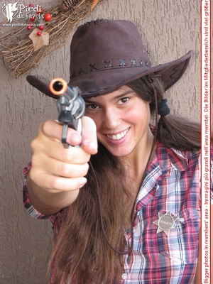 Little brunette pigtailed cowgirl wearing a hat, checked shirt and pantyhose looking dangerous with her gun - XXXonXXX - Pic 14