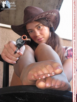 Little brunette pigtailed cowgirl wearing a hat, checked shirt and pantyhose looking dangerous with her gun - XXXonXXX - Pic 16