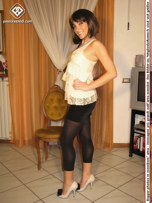 Cute teeny in a beige blouse and leggings takes off her shoes to flaunt her toes - XXXonXXX - Pic 1