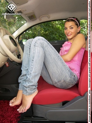 Ponytailed brunette teeny in a rose corset and jeans posing barefoot in the car - XXXonXXX - Pic 4