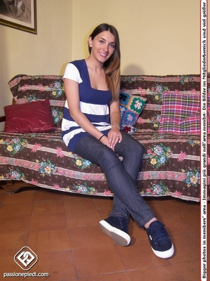 Brunette freshie in a striped T-shirt and jeans takes off her sneakers - XXXonXXX - Pic 1