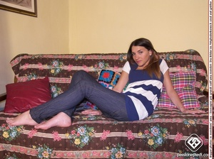 Brunette freshie in a striped T-shirt and jeans takes off her sneakers - XXXonXXX - Pic 3