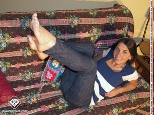 Brunette freshie in a striped T-shirt and jeans takes off her sneakers - XXXonXXX - Pic 4