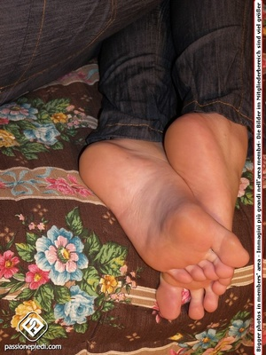 Brunette freshie in a striped T-shirt and jeans takes off her sneakers - XXXonXXX - Pic 5