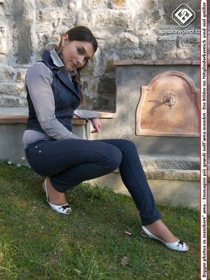 Lovely brunette teen in jeans and vest demonstrating her sexy feet in tights outdoors - XXXonXXX - Pic 1