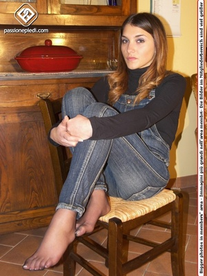 Brunette teen hottie in a jeans one-piece and pantyhose under it takes off her shoes - XXXonXXX - Pic 6