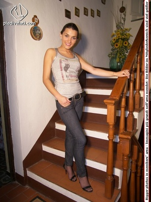 Ponytailed teen in a grey vest and jeans has black pantyhose under them - XXXonXXX - Pic 1