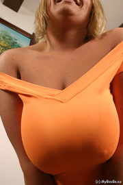 smiling blondie orange top