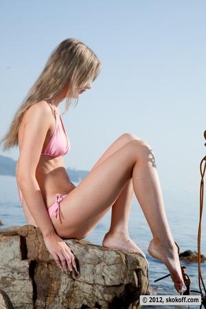 Fabulous fledgling in a pink bikini going topless on some rocks. - XXXonXXX - Pic 6