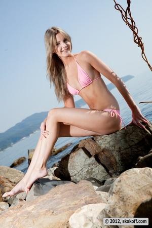 Fabulous fledgling in a pink bikini going topless on some rocks. - XXXonXXX - Pic 7
