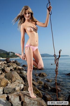 Fabulous fledgling in a pink bikini going topless on some rocks. - XXXonXXX - Pic 14