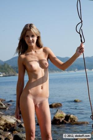 Fabulous fledgling in a pink bikini going topless on some rocks. - XXXonXXX - Pic 17