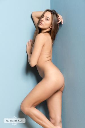 Wicked lady modeling her nude body against a blue wall. - XXXonXXX - Pic 5