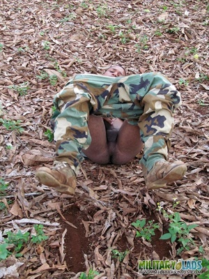 Gentleman in battle dress uniform lays down on fallen leaves to display his dick. - XXXonXXX - Pic 10