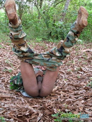 Gentleman in battle dress uniform lays down on fallen leaves to display his dick. - XXXonXXX - Pic 12