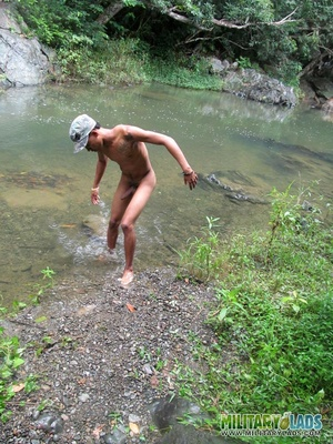 Young man drops his camo gear and gets in the river naked. - XXXonXXX - Pic 12