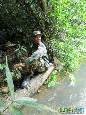 Buddies in camo gear get into some homo action in the river. - XXXonXXX - Pic 1