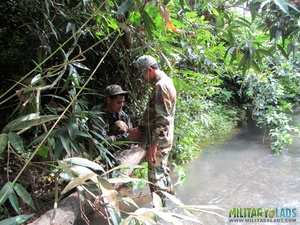 Buddies in camo gear get into some homo action in the river. - XXXonXXX - Pic 7