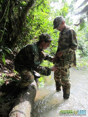 Buddies in camo gear get into some homo action in the river. - XXXonXXX - Pic 8