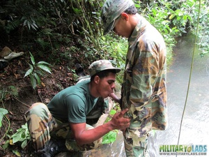 Buddies in camo gear get into some homo action in the river. - XXXonXXX - Pic 13