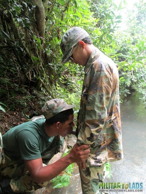 Buddies in camo gear get into some homo action in the river. - XXXonXXX - Pic 14