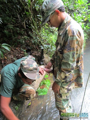 Buddies in camo gear get into some homo action in the river. - XXXonXXX - Pic 15