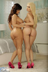 Bodacious brunette mom and cute blondie posing in pink outfits and high