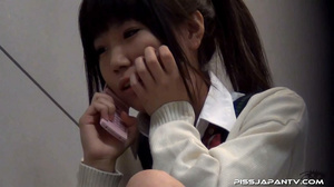 Cute Asian chick in school uniform take a piss then fingers hairy pussy - XXXonXXX - Pic 1