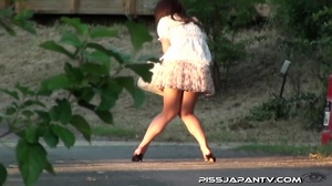 Cute Asian in sexy short skirt pressed on the streets hides to pee behind bench - XXXonXXX - Pic 4