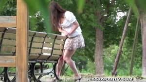 Cute Asian in sexy short skirt pressed on the streets hides to pee behind bench - XXXonXXX - Pic 13