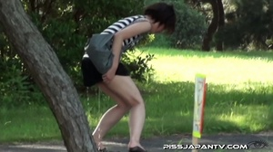 Naughty camera catches pressed Asian sexy babes spraying piss in public - XXXonXXX - Pic 13