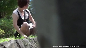 Young Asian hotties in public look for quiet play to spray piss outdoors - XXXonXXX - Pic 15