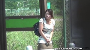 Young Asian babe on phone keeps talking as she finds a corner to piss outdoors - XXXonXXX - Pic 9