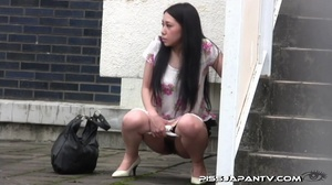 Chicks pissing outdoor gets interrupted but still spray water right out in public - XXXonXXX - Pic 2