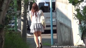 Asian beauty in stripped top and babe in short skirt bend and pee in public - XXXonXXX - Pic 2