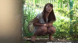 Asian beauty in stripped top and babe in short skirt bend and pee in public - XXXonXXX - Pic 5