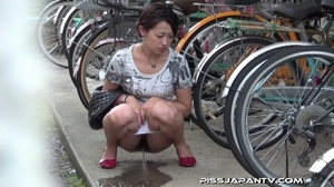 Slim Asian babe in tight jeans skirt bends twice to piss outdoors and wets self - XXXonXXX - Pic 5