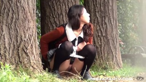 Hot dressed Asian chicks caught outdoors find quiet place to pee and show ass - XXXonXXX - Pic 9
