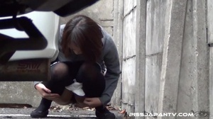 Hot dressed Asian chicks caught outdoors find quiet place to pee and show ass - XXXonXXX - Pic 13