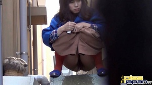 Asian hotties caught pressed on the streets looks for spots to spray piss - XXXonXXX - Pic 1