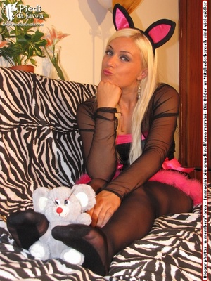 Cat woman in black costumes and black heels does her striptease on a zebra print couch. - XXXonXXX - Pic 9