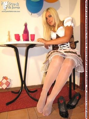 White snow girl in white costumes and stocking pose sexy on a black seat indoors. - XXXonXXX - Pic 4